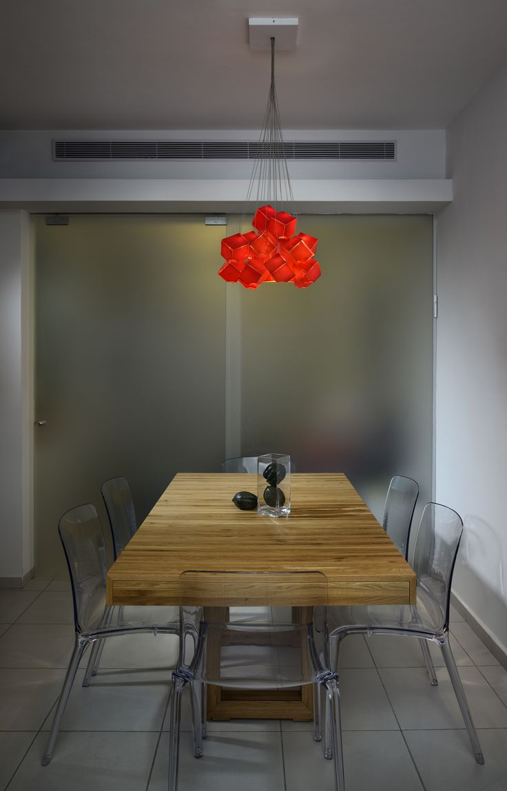 View Dining Room With Red Accent Lighting Fixture