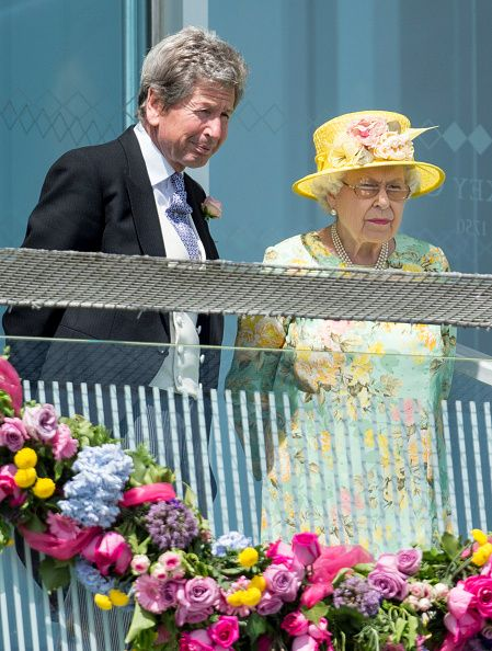 Queen Elizabeth II and John Warren watching the racing from the royal balcony during Derby day at Epsom Derby festival at Epsom Downs on June 3, 2017 in Epsom, England.