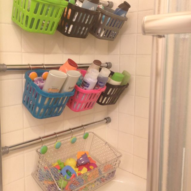 "Finally organized all 7 kids bathroom ""stuff"". Tension rods with dollar store baskets!! I'm so happy to have nothing in the bathtub!!"