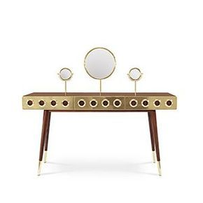 If you are a fan of the James Bond world, you will certainly be dazzled with this golden eye‐catching piece. We named this sideboard Monocles and it is 100% prepared for Martini and Gin bottles. It is made in solid walnut wood and brass with knurled details. Circles are engraved on the sides and the back in the walnut wood, while three golden doors fulfill the setting with a kind of 'kiss kiss bang bang' spirit.