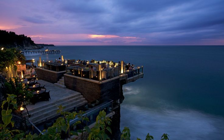 Simply Fantastic! Rock Bar, Bali Admittedly more rock-top than rooftop, the Rock Bar at AYANA Resort and Spa is located on natural rocks 14 metres above the Indian Ocean. Understandly popular with drinkers who want to admire the setting sun, the bar also hosts DJ performances and remains a popular spot after dark.