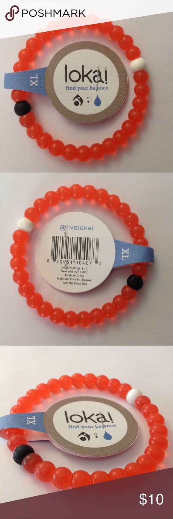 Lokai orange bracelet promotes strength & clarity Beautiful orange Lokai bracelet for clarity, balance, and inner peace, promotes a calming presence. Contains minerals from the Dead Sea.  Promotes Strength with beauty, size XL - measures 3 inches wide Lokai Jewelry Bracelets