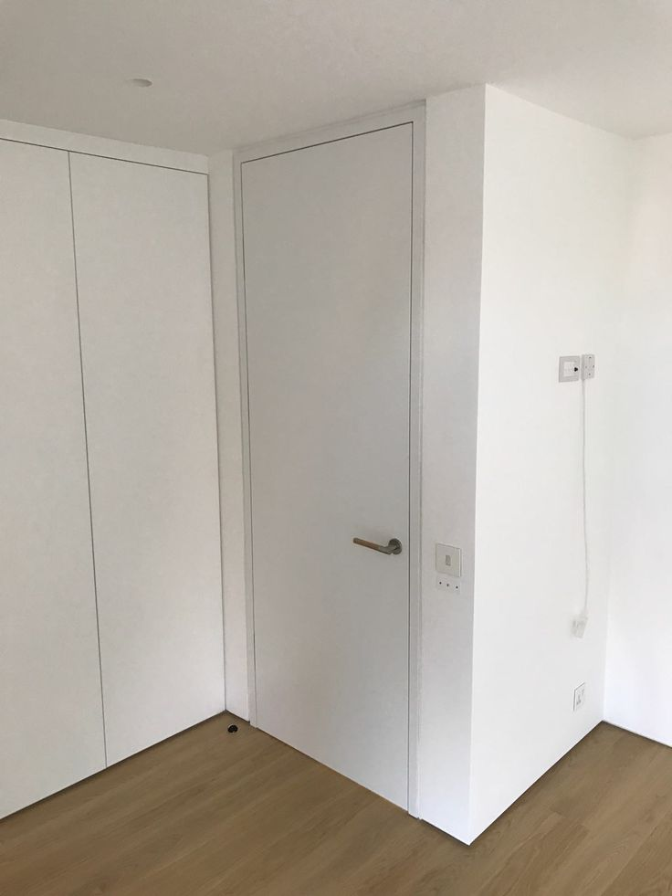 Full height custom door with  automatic lock and shadow gap by Sharp Projects