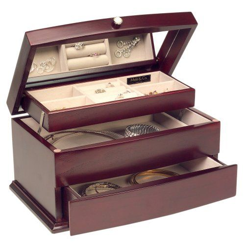 http://103rdavenue.com/mele-co-meghan-cherry-jewelry-box/ This cherry finished jewelry box sits upright and is lined with sand sueded fabric inside. There are four open compartments, ring rolls and an automatic drawer with tray.