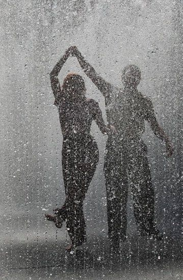 """dancing in the rain...""""What we find in a soulmate is not something wild to tame but something wild to run with."""" ~Robert Brault"""
