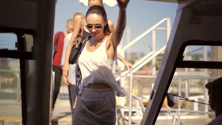 Model Vanya leads the way onto the boat to jet-set over to The Sydney Island