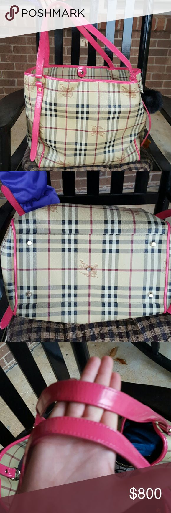 Large Burberry Haymarket Authentic Large Burberry Haymarket with pink trim in excellent condition. Is a great tote with plenty of room.  Made in Italy. A detachable pouch included. No dust bag. Burberry Bags Shoulder Bags