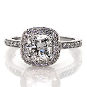 Lovely diamond engagement ring will add sparkle to your day. The halo and band are both done with micro pave and support the cushion cut center stone. Cushion Amante from Knox Jewelers #halo #milgraine #cushioncut