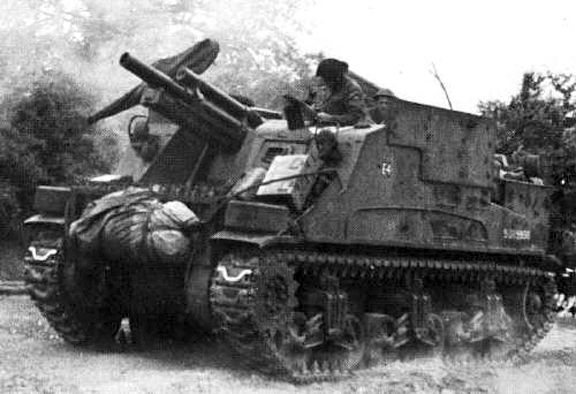 "An example of the M7 'Priest' 105-millimetre self-propelled gun, pictured here as No. 4 gun, ""E"" Troop, 78th Field Battery, 13th Canadian Field Regiment, Royal Canadian Artillery, 3rd Canadian Infantry Division, in Normandy, July 1944. This particular vehicle (S215830) was itself converted to a 'Priest' Kangaroo armoured personnel carrier, and subsequently was one of the initial 50 issued to the 1st Canadian Armoured Personnel Carrier Squadron, on 1 September 1944. Source: MilArt photo…"