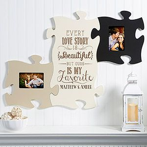 OMG I LOVE LOVE LOVE these! It's a Puzzle Piece Wall Frame Collection! You can choose what design you want for the middle and personalize it with your names and then add as many puzzle frames you want to either side! This is SOOOO pretty! I need it!! Grea