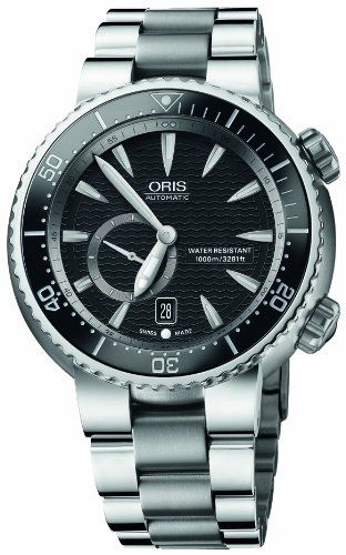 Oris Men's 643 7638 7454MB Divers Titan Small Second Date Watch - Titanium case with a titanium link bracelet. Fixed stainless steel bezel. Black dial with luminous hands and index hour markers. Minute markers on the outer rim. Date display at the 6 o'clock position. Seconds sub-dial at the 8 o'clock position. Swiss automatic movement movement. Scratch resistant sapphire crystal. Screw down crown. Screw down case back. Case diameter: 47mm. Fold ...