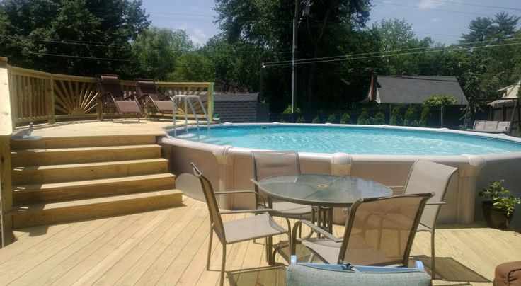 Above ground pool deck deck stairs sunburst railings for Above ground pool bar ideas