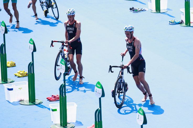 Jonathan Brownlee of Great Britain (L) and Alistair Brownlee of Great Britain compete during the Men's Triathlon at Fort Copacabana on Day 13 of the 2016 Rio Olympic Games on August 18, 2016 in Rio de Janeiro, Brazil.