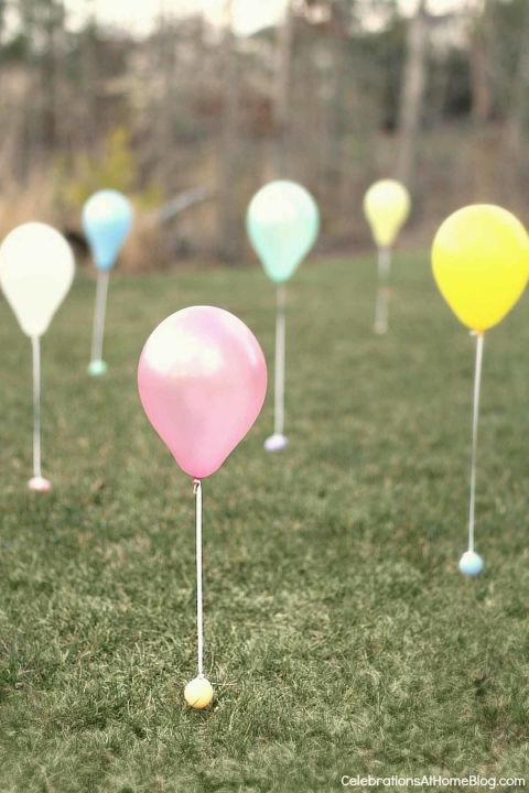 Balloon Egg Hunt: Everyone loves a good Easter hunt, but the kids will love it even more when balloons are attached to the plastic eggs. Plus, this makes it easy for little ones to play too. Click through for more fun Easter egg hunt ideas for kids and adults.