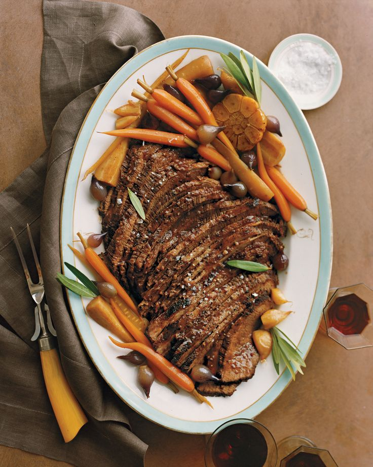Braised Brisket with Carrots, Garlic, and Parsnips   Martha Stewart Living - Brisket is often part of a traditional Passover meal. For step-by-step photos, see our Brisket 101 How-To.