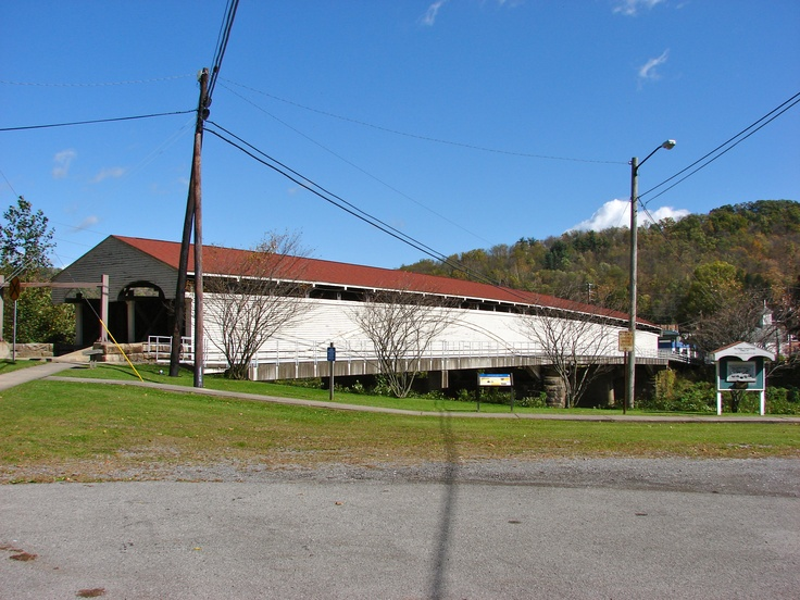 The Covered Bridge over the Tygart Valley River at Philippi, West Virginia. It is notable for its use during the first land battle of the Civil War; it is also the only twin-barreled covered bridge on a federal highway in the U.S. and it is one of the longest covered bridges in the country. [Photo taken by J.Lewis with a 6 MP digital camera.]