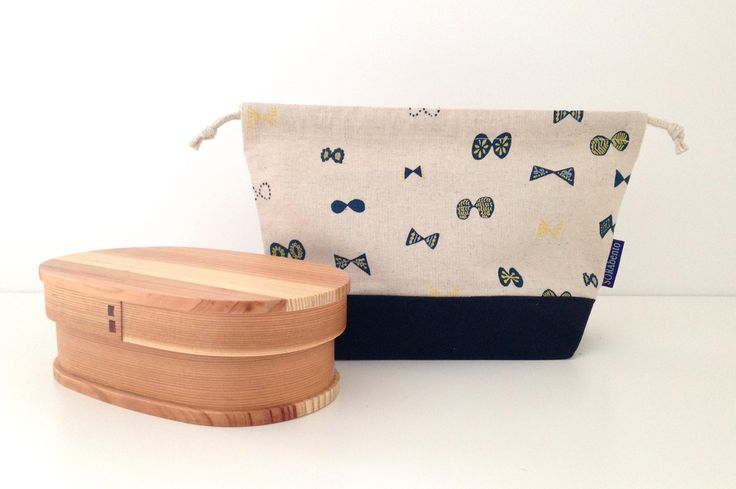 Button butterfly bento bag. Linen and canvas fabric with woven hemp cords.