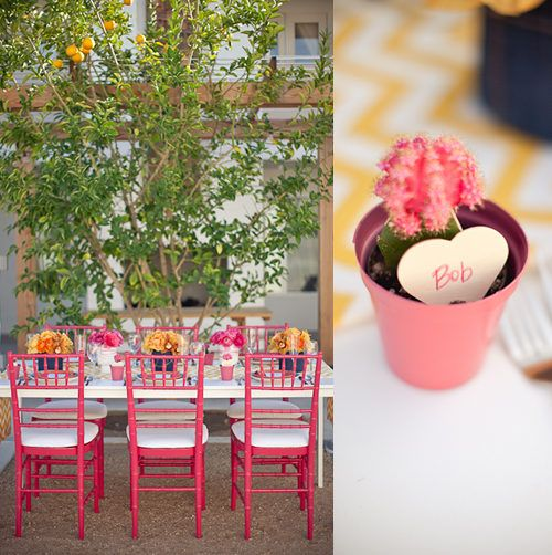 Pink chairs, outdoor seating, simple floral centerpieces.