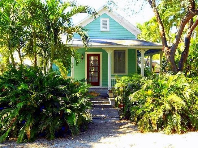 Key west style cottage in turquoise and lime
