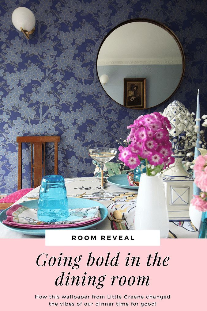 How I used bold wallpaper to elevate my home decor | Little Greene Camelia wallpaper in my dining room with a round mirror and brass wall lights by Michael Anastassiades for FLOS. An eclectic table setting with pink and blue for a fun family home. How to work with bold wallpaper in your home.