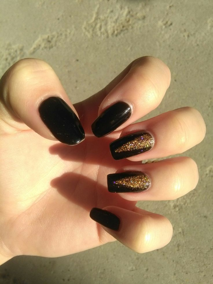 black nails with holographic gold glitter