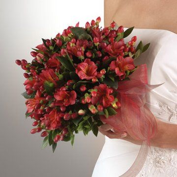 Red alstroemeria and hypericum berries (also known as coffee berries) make a stunning, yet simple bouquet.