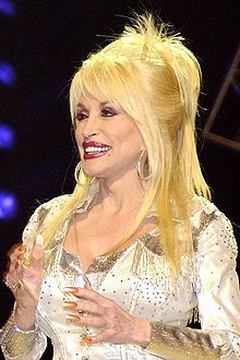Dolly Parton...I love Dolly!  She is a great lady, humanitarian & what a beautiful voice!