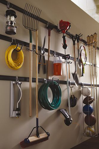 Rubbermaid FastTrack Garage Organization System.  Want!!!!  And I soooooo want my shed to look like this!