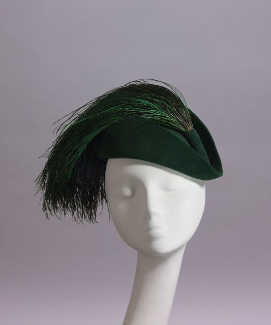 House of Nines Maxima hat with peacock feathers.