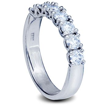 White Gold ladies wedding band with round brilliant diamonds in claw setting