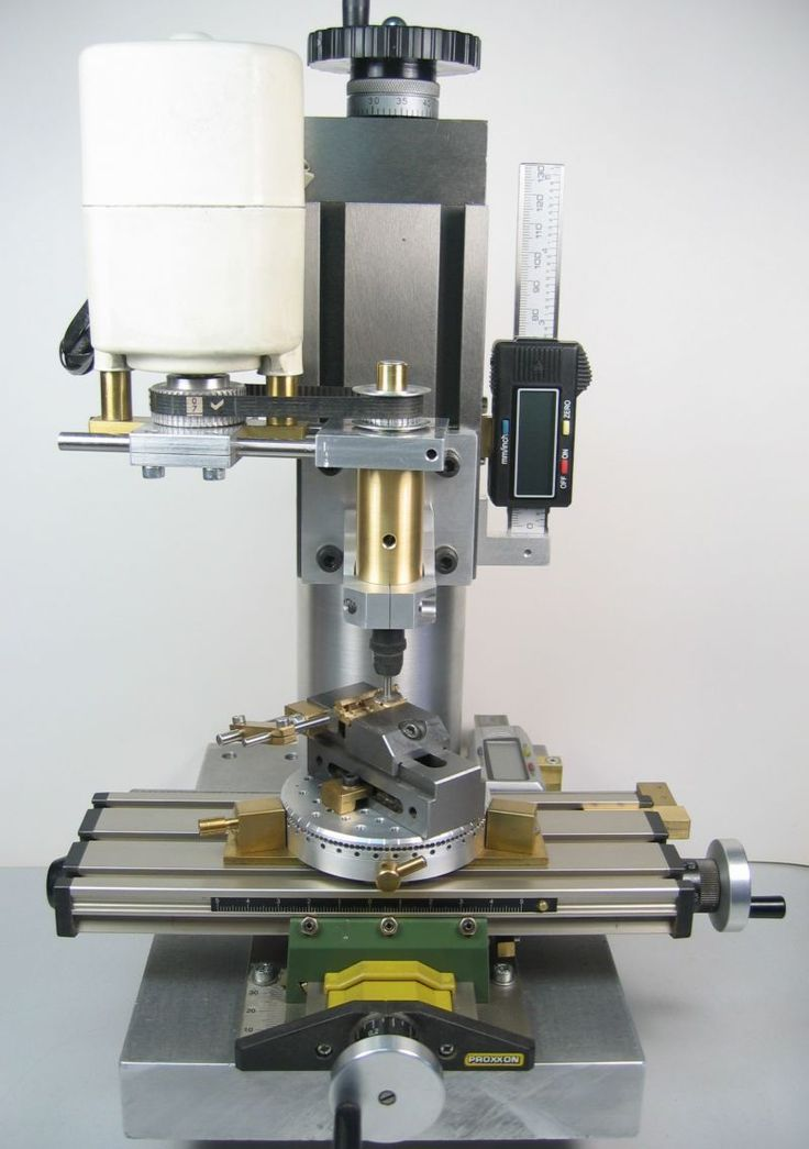 """A small homemade milling machine for desktop machining (3.5"""" from column to spindle center and 7.5"""" from milling table to spindle clearance)"""