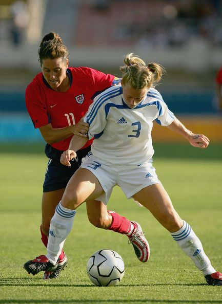 Julie Foudy  11 of the USA and Sophia Smith  3 of Greece go for the ball in  the women s football preliminary match on August 11 4f8b864efe