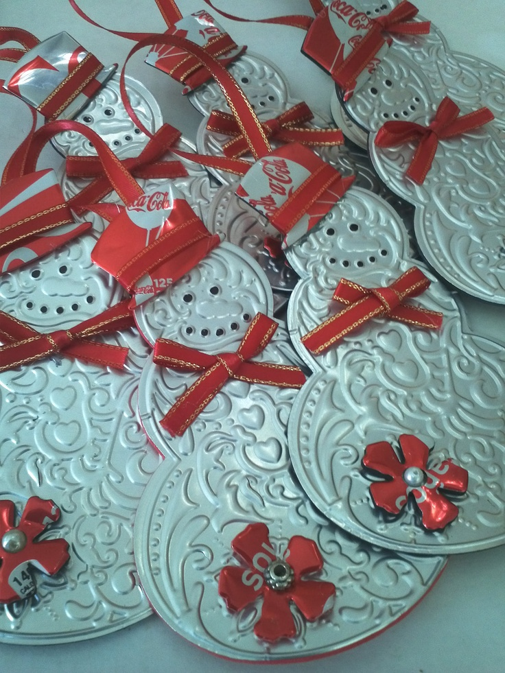 Repurposed soda cans made into Christmas ornaments using sizzix machine