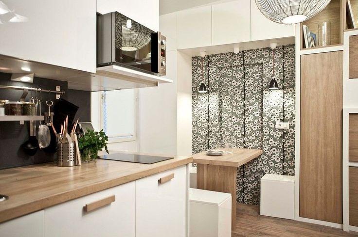 Раскладные столы для маленькой кухни: как оптимизировать кухонное пространство и обзор наиболее удобных современных моделей http://happymodern.ru/kuxonnye-stoly-raskladnye-dlya-malenkoj-kuxni/ Раскладывающийся обеденный стол, закрепленный на стене, имеет нишу в стене, куда прячется за ненадобностью. Компактное размещение кухонной мебели выполняет сразу несколько функций, что ценно для малогабаритной кухни