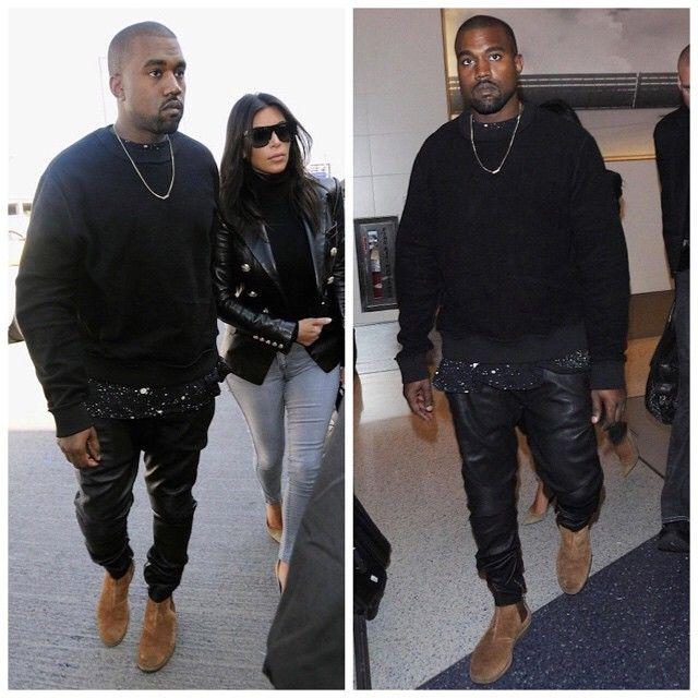 Kanye-West-wears-inside-out-sweatwshirt-Yeezus-Tour-Vegas-Tee-Merch-paint-splatter-tee-Balmian-biker-leathe-sweatpants-and-Bottega-Veneta-Boots-Shoes-11