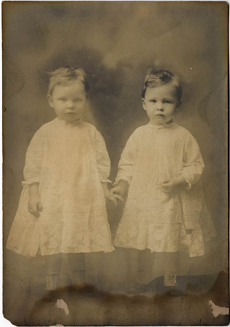 vintage photo-twins. So sweet. Looks like boys with the side parts. Not sure though.