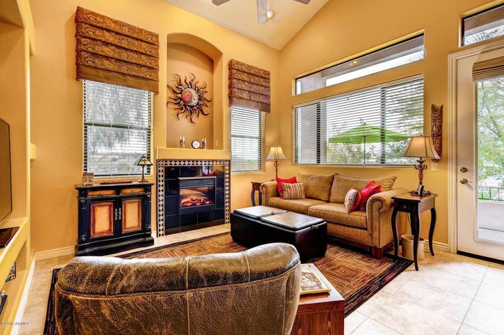 Mediterranean Living Room with Ceiling fan, Pulaski Timeless Classics 1 Drawer 2 Door Teo Toned Accent Chest, Carpet