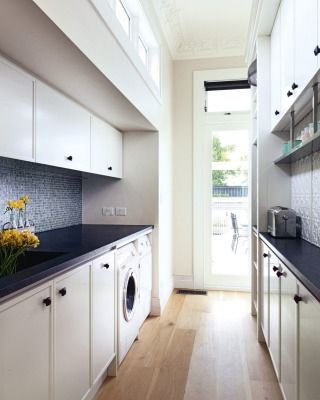 "WHAT THE JUDGES SAID: ""Every detail in this kitchen and laundry area – from the lights, to the cornices to the cupboards – has been carefully considered. We loved the discrete LED lights and the birdcage pendant lights; the custom designed cornices, and the cunning sliding doors. The colour works, the layers of texture are magnificent. A truly elegant space."""