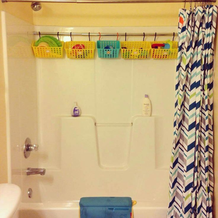 Never thought about saving space by putting in an extra shower rod to hold bins for bath toys!!!