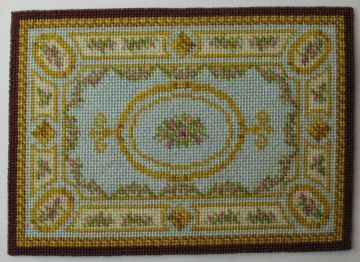 "1:48 scale Aubusson rug, circa 1880. Needlepoint design by Anna-Carin Betzén, based on a full-scale rug    Stitched with DMC floss on 48 count silk gauze, the Aubusson rug measures 44×63 mm (1 3/4""×2 1/2""), plus fringe."