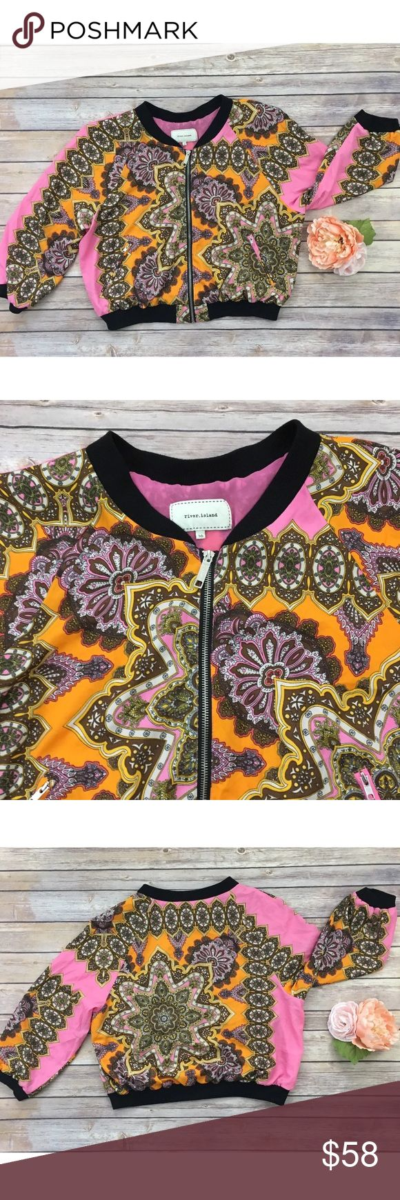 """River Island Paisley Bomber Jacket River.island brand bomber jacket. Updated urban Paisley print. Pink and orange. Polyester with full pink lining. UK design. UK 14/US 10/ Eur 42. Gently used, no flaws. Please see pictures for details.   Armpit to armpit - 22.5""""  Shoulder to hem - 21""""  Sleeve length - 23"""" River Island Jackets & Coats"""
