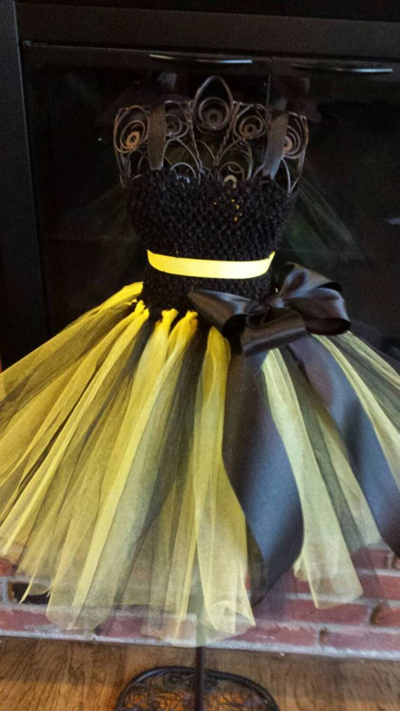 Buzzz!!! This adorable Bumblebee tutu Dress is absolutely perfect for a costume or for any festivity! Available as a dress only or with add ons