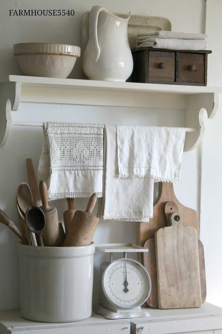 Farmhouse Kitchen - white painted furniture and neutral wood tones - a collection of vintage ironstone, linens and kitchen utensils displayed in a crock - via Farmhouse 5540