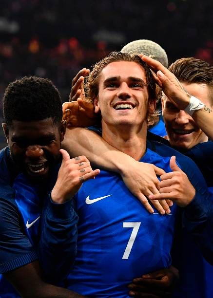"""France's forward Antoine Griezmann is congratulated by teammates after a goal that was finally disallowed for offside during the friendly football match France vs Spain on March 28, 2017 at the Stade de France """
