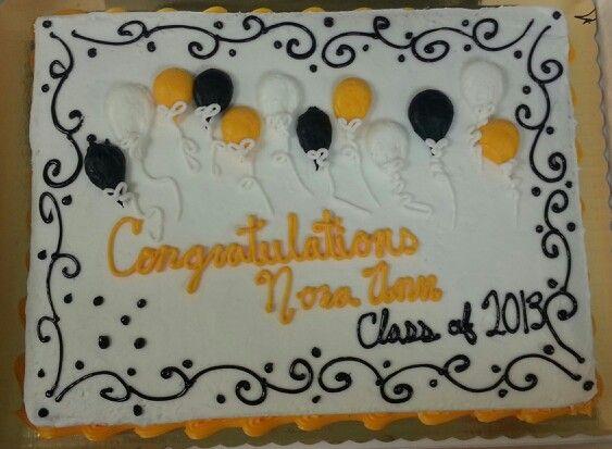 Decorating a cake for graduation