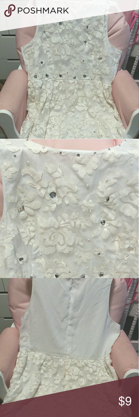 Light cream color dress Dress with flower lace design and different silver rhinestones thru out the dress..back unzips the back..has a small blue dot stain on back seen in 4th picture Dresses
