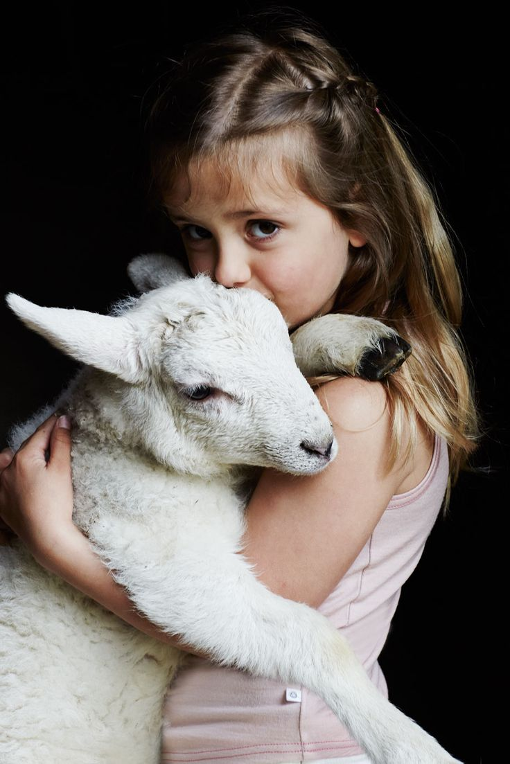 Grace wears her Smalls...on the Farm.  This is one of our new pet lambs...Precious.