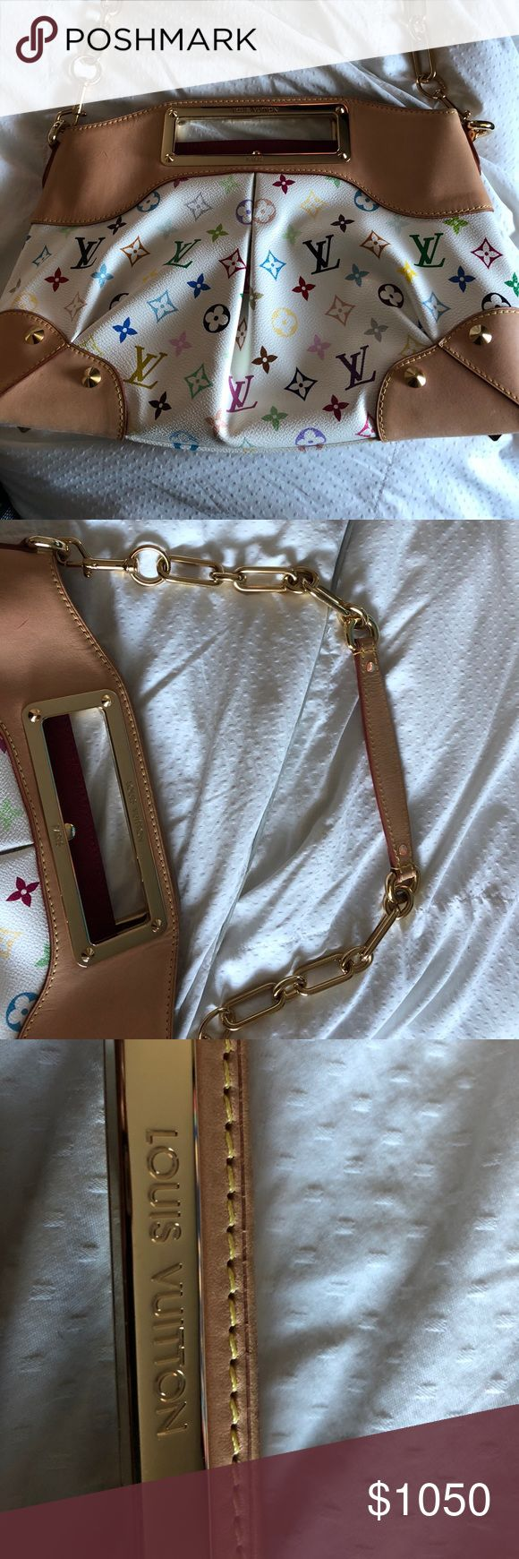 Louis Vuitton Handbag/Clutch This bag is from a few years ago. It's the white multi colour from LV. Had raspberry interior and it looks brand new. I used it twice! I guarantee all my items authentic  purchased right from LV. If you have questions contact me. 9 out of ten if I habe to rate it. Comes with dustbag! Louis Vuitton Bags Shoulder Bags