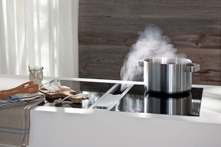 more effective than current hoods, the system directly Bora sucks odors and fumes that occur in kitchen stoves and pans from the hob. | Bora hood |