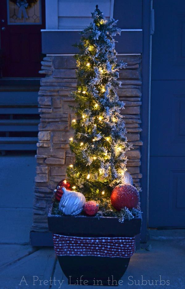 Make your own outdoor Christmas trees with lights, using tomato cages and evergreen garland!